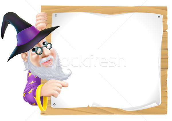 Wizard pointing at sign Stock photo © Krisdog