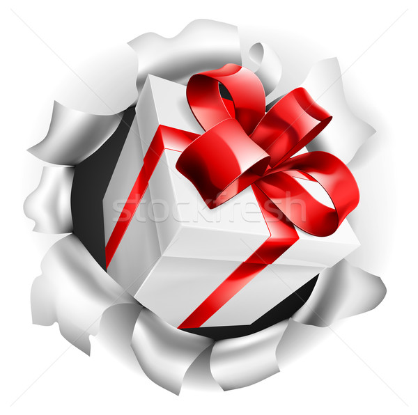 Stock photo: Gift Present Ripping Through Background