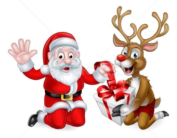 Santa and Reindeer with Christmas Gift Stock photo © Krisdog