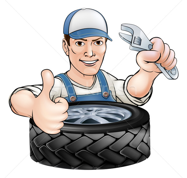 Mechanic with wrench and tyre Stock photo © Krisdog