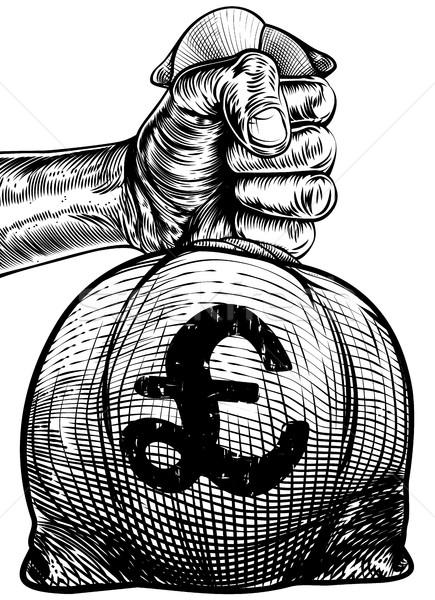 Hand Holding a Pound Sign Burlap Sack Money Bag Stock photo © Krisdog