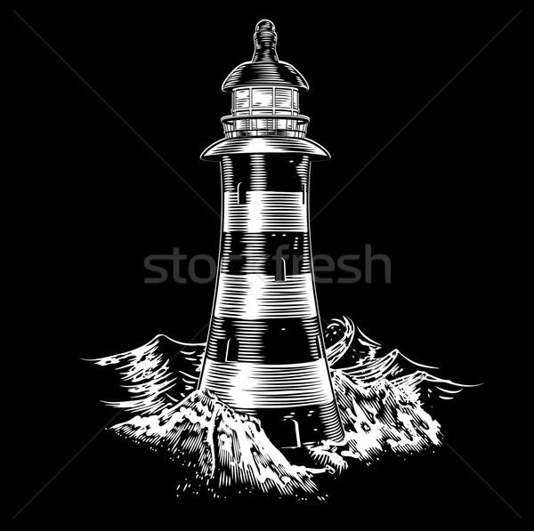 Lighthouse at night with rough sea Stock photo © Krisdog