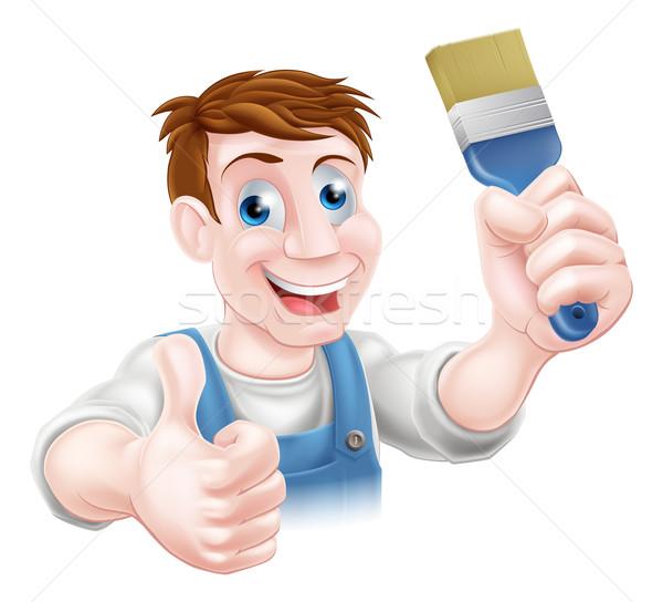 Decorator holding paintbrush Stock photo © Krisdog