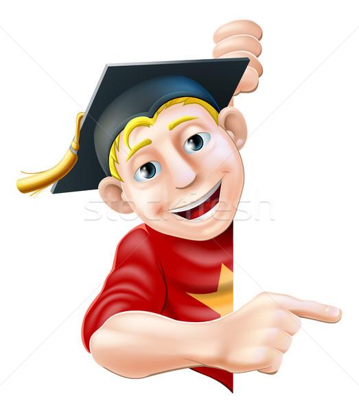 Graduate pointing Stock photo © Krisdog