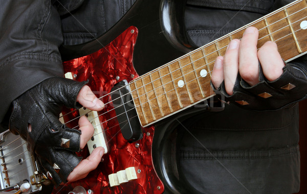 Hands rock musician with a guitar  Stock photo © krugloff