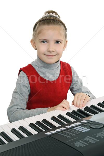 Kız oynama dijital klavye öğrenme oynamak Stok fotoğraf © krugloff