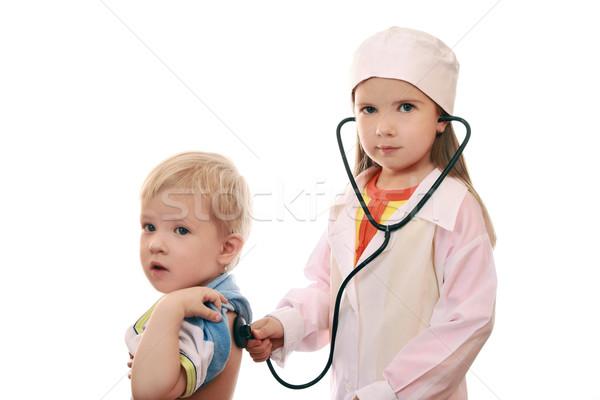 Jeu garçon réception médecin fille Retour Photo stock © krugloff