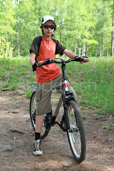 The teenager in a wood on a bicycle  Stock photo © krugloff