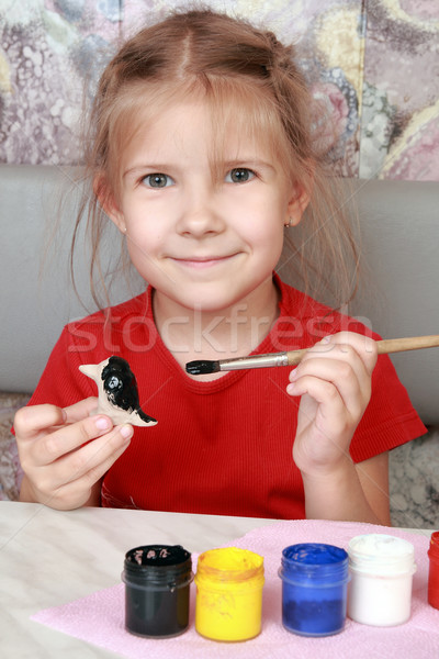 Smiling girl paints crafts Stock photo © krugloff