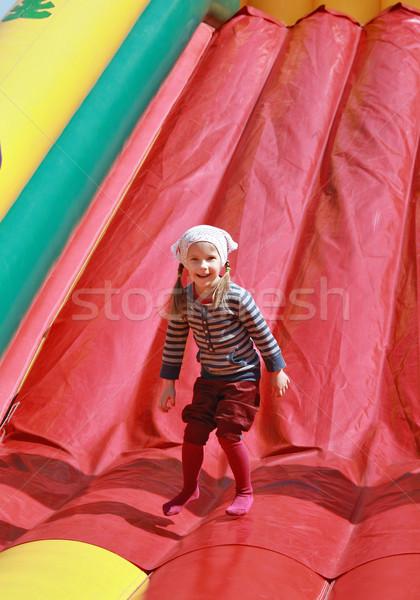 Satisfait fille sautant jouer gonflable printemps Photo stock © krugloff