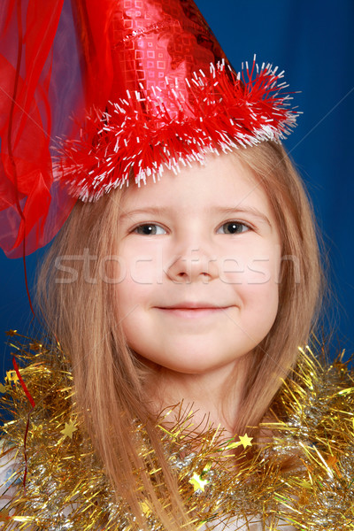 The cheerful girl in a red cap Stock photo © krugloff