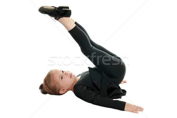 Stock photo: Girl performs gymnastic exercise