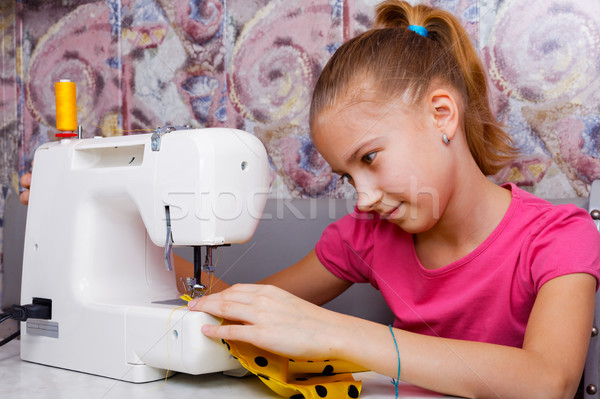 Girl learns to sew Stock photo © krugloff