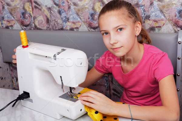 Girl learns to sew on an sewing machine Stock photo © krugloff