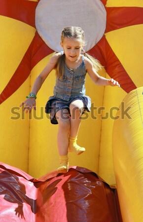 Sautant fille gonflable enfant été rire Photo stock © krugloff