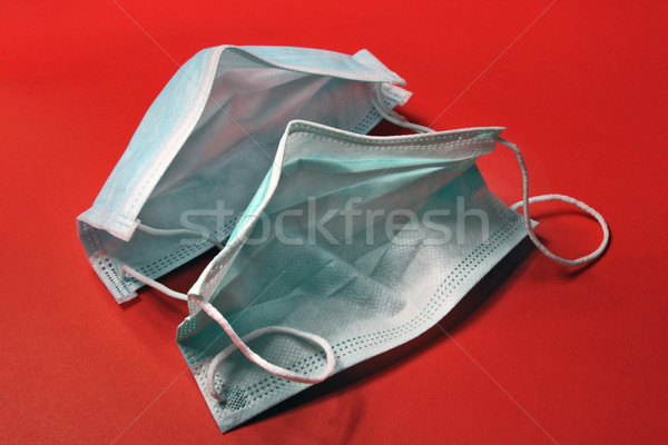 Disposable medical masks on a red background   Stock photo © krugloff