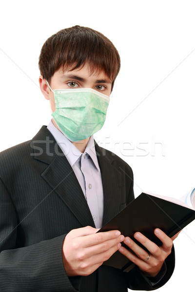 The student with a book in the medical mask  Stock photo © krugloff