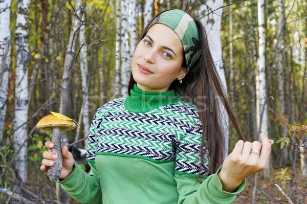 Girl collects mushrooms in the forest  Stock photo © krugloff