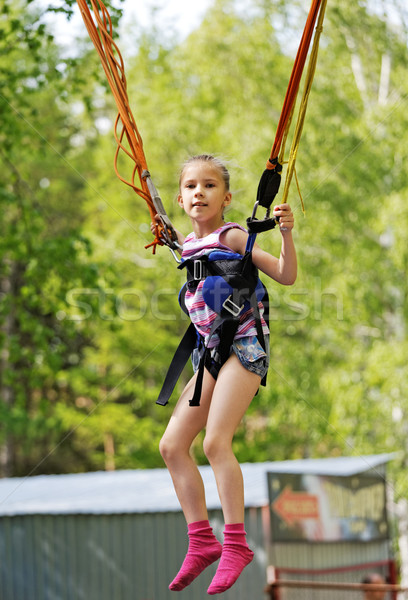 Girl jumping on a trampoline kangaroo   Stock photo © krugloff