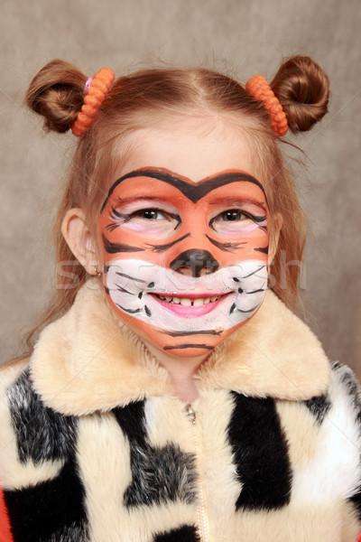 Souriant fille image tigre peint comme Photo stock © krugloff