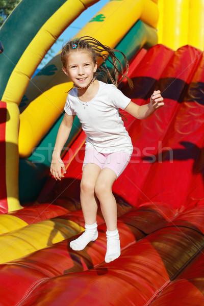 Fille sautant trampoline funky amusement été Photo stock © krugloff