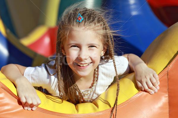 Gelukkig meisje carrousel ontspannen zomer park Stockfoto © krugloff