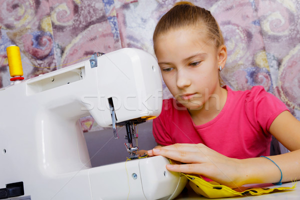 A teenage girl learns to sew Stock photo © krugloff