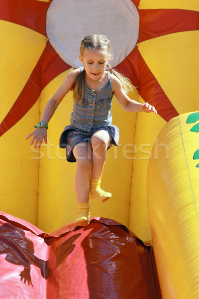 Jumps on inflatable attractions   Stock photo © krugloff