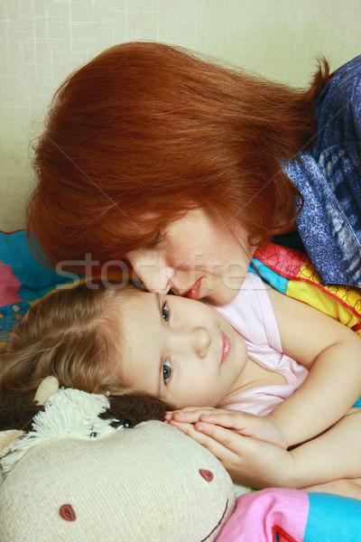 Mum kisses a daughter before a dream Stock photo © krugloff