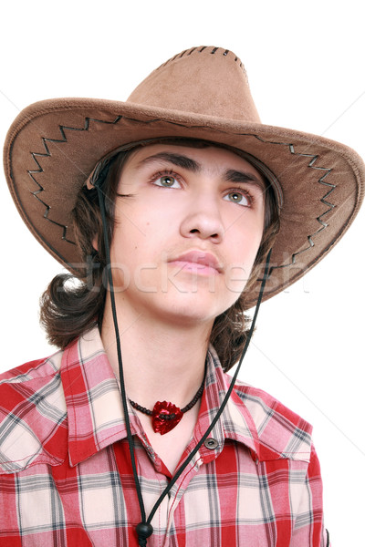 Thoughtful young man holds a cowboy hat   Stock photo © krugloff
