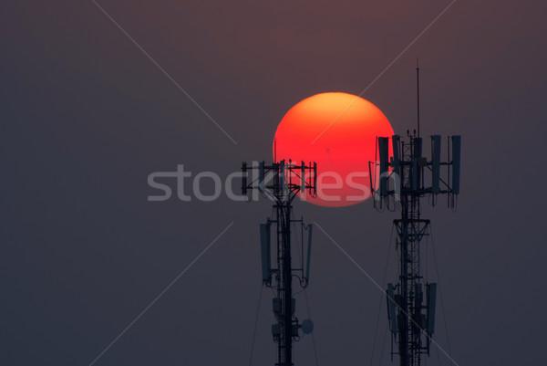 башни сотовых связи закат солнце Сток-фото © kttpngart