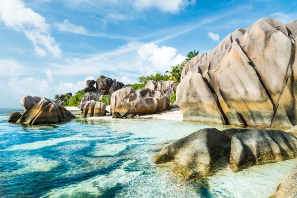 Praia granito turquesa mar céu água Foto stock © kubais