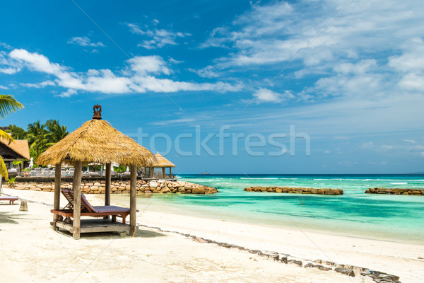 beach beds with roof and turquoise sea Stock photo © kubais