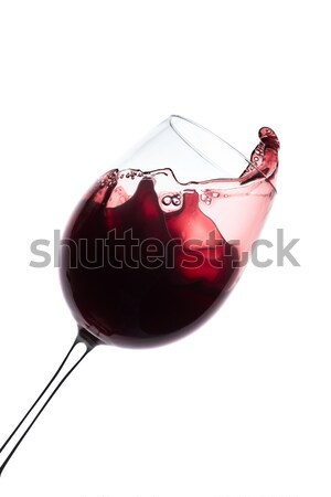 red wine splashing out of a glass, isolated on white Stock photo © kubais