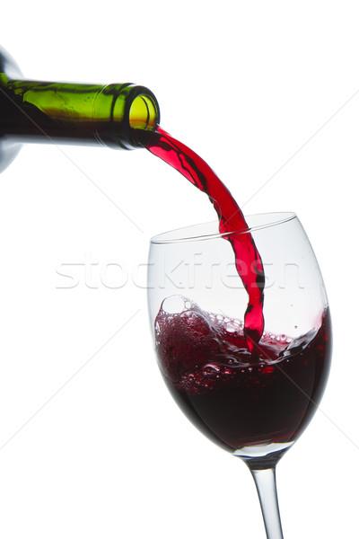 Vörösbor csobbanás áramló borospohár izolált bor Stock fotó © kubais