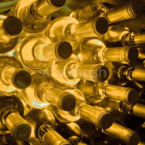 Vinho garrafas para cima caverna parede Foto stock © kubais