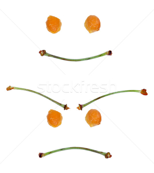 happy and angry face made from stalks of sweet cherries an Stock photo © kuligssen