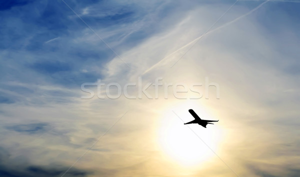 Düzlem gün batımı uçak uçan turuncu hızlandırmak Stok fotoğraf © kuligssen