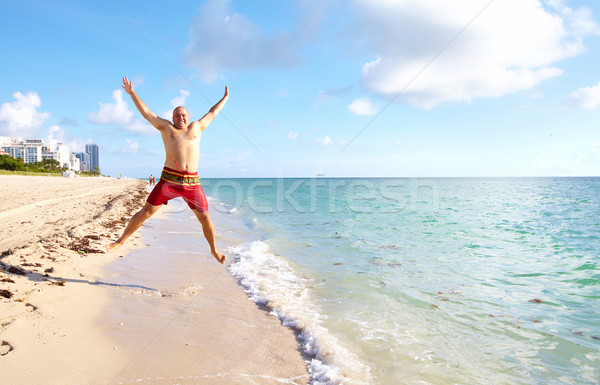Feliz homem Miami praia saltando férias Foto stock © Kurhan