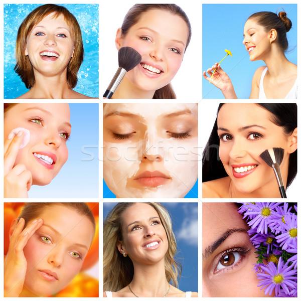 Pretty smiling women applying make up.  Stock photo © Kurhan