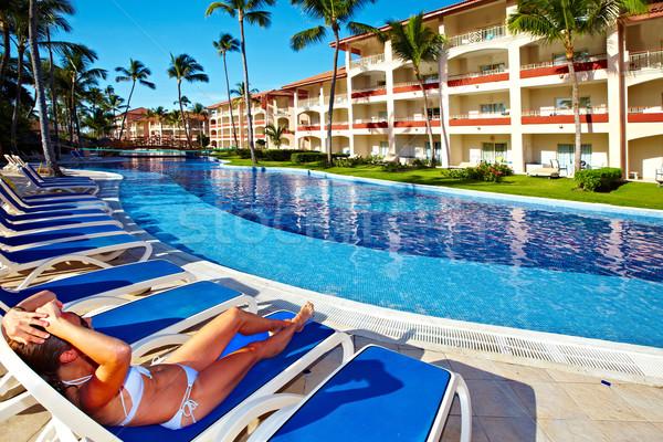 Mulher relaxante piscina férias caribbean recorrer Foto stock © Kurhan