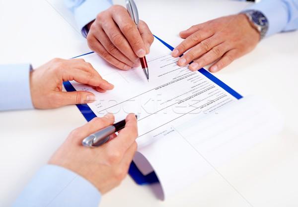 Kezek üzletemberek dolgozik iroda iratok papír Stock fotó © Kurhan