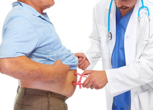 Medical doctor with body fat calipers. Stock photo © Kurhan