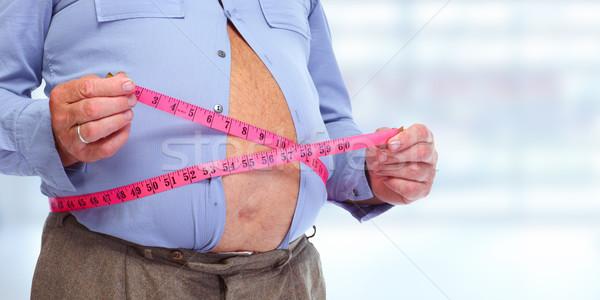 Fettleibig Mann Abdomen Maßband Fettleibigkeit Gewichtsverlust Stock foto © Kurhan