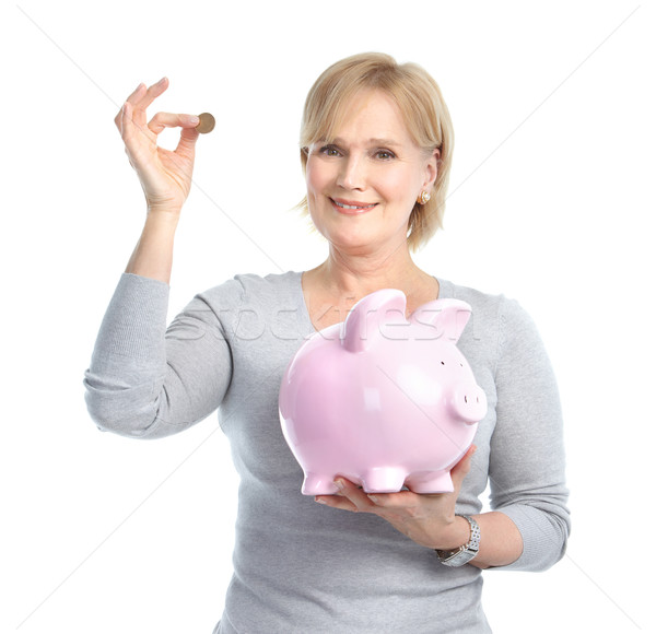 Woman with a pig bank Stock photo © Kurhan