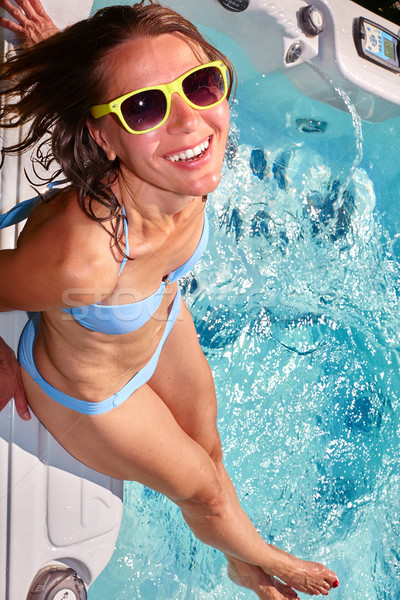 Happy woman relaxing in hot tub. Stock photo © Kurhan