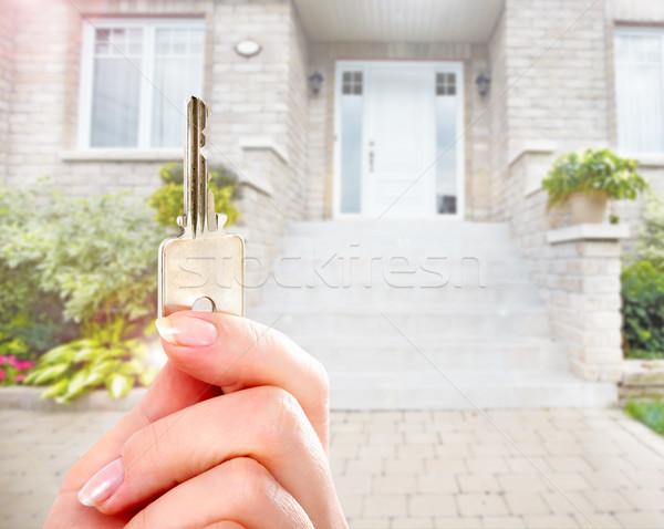 Hand with house key. Stock photo © Kurhan