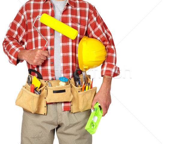 Builder handyman with paint roller. Stock photo © Kurhan