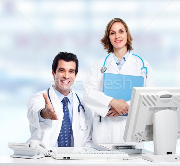 Group of medical doctors. Over blue background. Stock photo © Kurhan