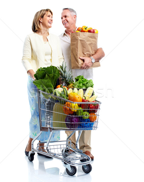 Stock photo: Senior couple with a grocery shopping cart.
